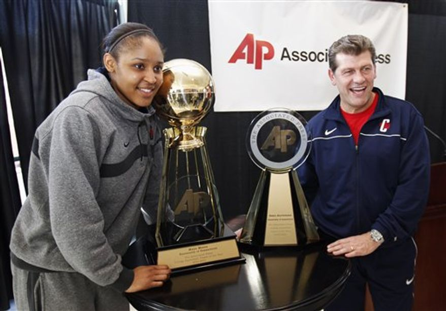 Connecticut's Maya Moore poses with her award after being named The Associated Press player of the year at the women's NCAA Final Four college basketball tournament in Indianapolis, Saturday, April 2, 2011. (AP Photo/Michael Conroy)