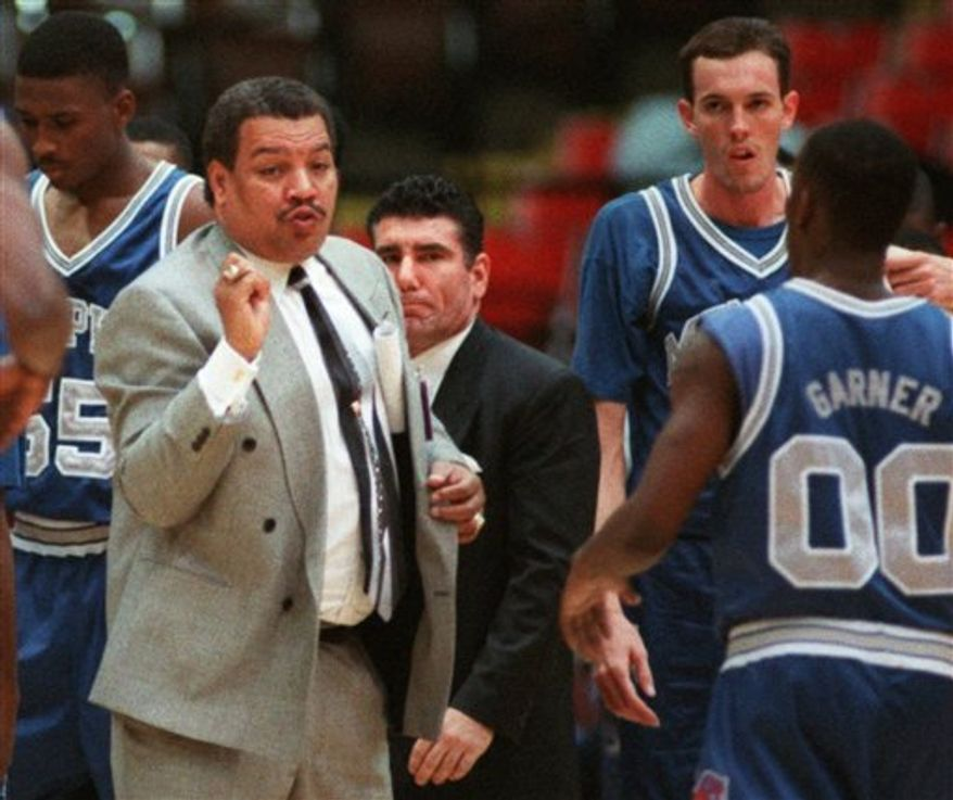 FILE - In this Feb. 1, 1996 file photo, Memphis coach Larry Finch talks with Chris Garner (00) during a timeout in the first half against DePaul in an NCAA college basketball game in Rosemont, Ill. Finch, who coached his alma mater Memphis for 11 seasons after a brief pro basketball career as a player, died Saturday, April 12, 2011. He was 60. (AP Photo/Fred Jewell, File)