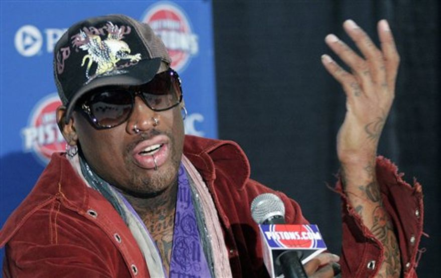 ** FILE ** Former Detroit Piston Dennis Rodman during a press conference at The Palace before an NBA basketball game in 2011. Mr. Rodman was being honored with the retirement of his No. 10 jersey during a half-time ceremony. (AP Photo/Duane Burleson)