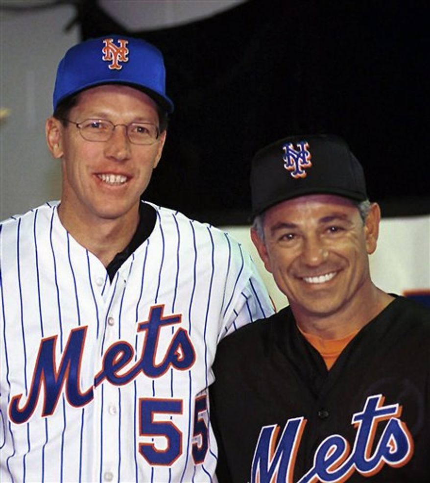 "FILE - In this March 25, 1999 file photo, pitcher Orel Hershiser, left,, joined by New York Mets manager Bobby Valentine has a big smile on his face after signing with the baseball team during a news conference in Port St. Lucie, Fla. After 21 years, ""Sunday Night Baseball"" is getting a new sound. Hershiser , Valentine and Dan Shulman make their debut Sunday on ESPN, replacing Jon Miller and Joe Morgan. (AP Photo/Steve Mitchell, File)"