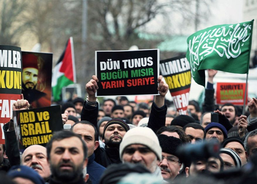 Pro-Islamic demonstrators in Istanbul support protesters in Egypt during a rally in February. Turkey has indicated a goal to be a power broker on the world stage with its responses to recent unrest in the Middle East. (Associated Press)