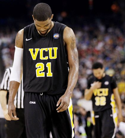 VCU's Jamie Skeen leaves the court after his team loses 70-62 to Butler in the first NCAA Final Four game Saturday night in Houston. (Associated Press)