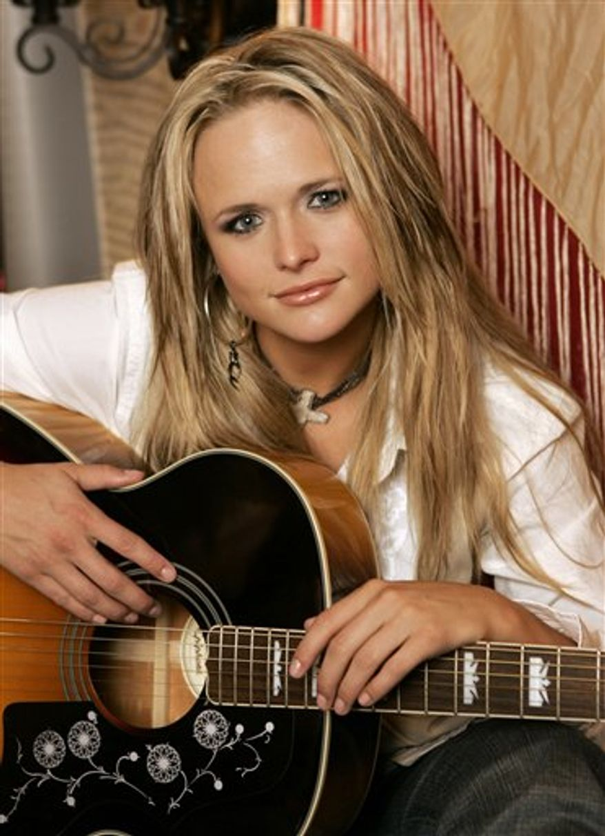 FILE - In this March 21, 2007 file photo, Miranda Lambert is shown on her tour bus in Nashville, Tenn., (AP Photo/Mark Humphrey, File)
