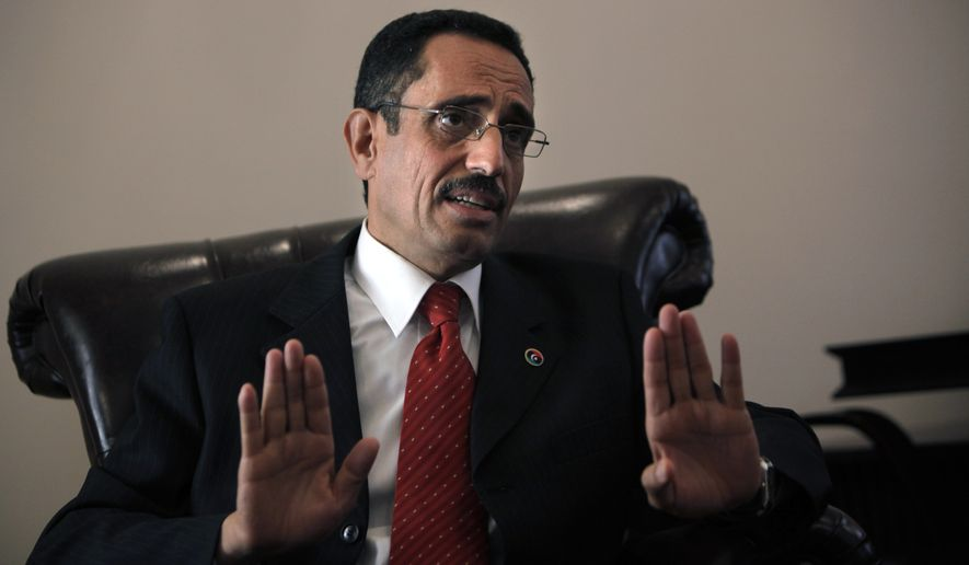 Abdel-Hafidh Ghoga, vice chairman of the Libyan rebels' National Provisional Council, gives an interview to the Associated Press in Benghazi, Libya, on Sunday, April 3, 2011. The rebel movement, which controls the country's eastern half, wants to install a parliamentary democracy once it topples the regime of longtime ruler Col. Moammar Gadhafi, Mr. Ghoga said Sunday. (AP Photo/Nasser Nasser)