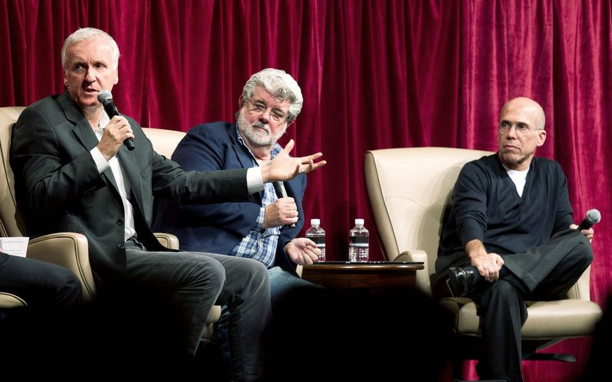 "James Cameron (left) speaks about digital filmmaking as George Lucas (center) and Jeffrey Katzenberg look on during a panel discussion at the CinemaCon conference last week in Las Vegas. Mr. Cameron had delayed filming ""Avatar"" until digital technology caught up with his concept for the movie. (Associated Press)"