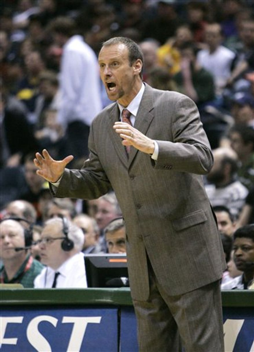 FILE - In this March 12, 2008 file photo, Milwaukee Bucks coach Larry Krystkowiak is seen during the first half of an NBA basketball game in Milwaukee. The University of Utah hired Larry Krystkowiak as their coach Sunday, April 3, 2011, picking him to lead the Utes into the Pacific 12 Conference. (AP Photo/Morry Gash, File)