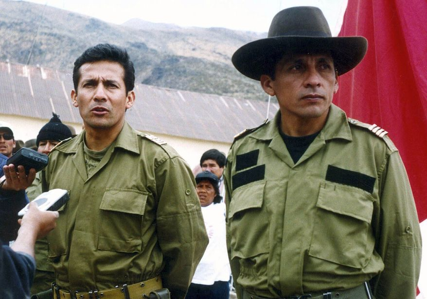 Ollanta Humala (left), a former Peruvian army officer and current presidential candidate, talks with reporters next to his brother, Antauro Humala, during their short-lived military rebellion in October 2000. (Associated Press)
