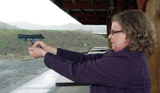 Cynthia Willis visits a firing range in White City, Ore. She is suing the Jackson County sheriff over the denial of a concealed-handgun permit after acknowledging that she uses marijuana to treat arthritis and muscle spasms. (Associated Press)