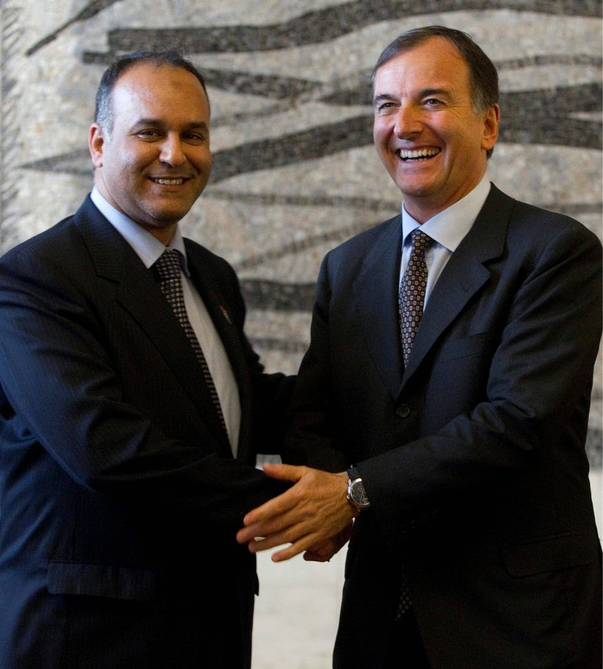 Libyan Interim National Transitional Council Foreign Minister Ali Al Issawi (left) and Italian Foreign Minister Franco Frattini show accord during a joint news conference in Rome on Monday. (Associated Press)