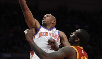 New York Knicks' Chauncey Billups shoots over Cleveland Cavaliers' J.J. Hickson during the first half of NBA basketball game, Sunday, April 3, 2011, at Madison Square Garden in New York. (AP Photo/Stephen Chernin)