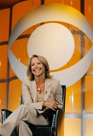 """FILE - In this July 16, 2006 file photo, Katie Couric, CBS News anchor and correspondent, answers questions about her upcoming season anchoring """"CBS Evening News with Katie Couric"""" during a news conference in Pasadena, Calif. (AP Photo/Lucas Jackson, File)"""