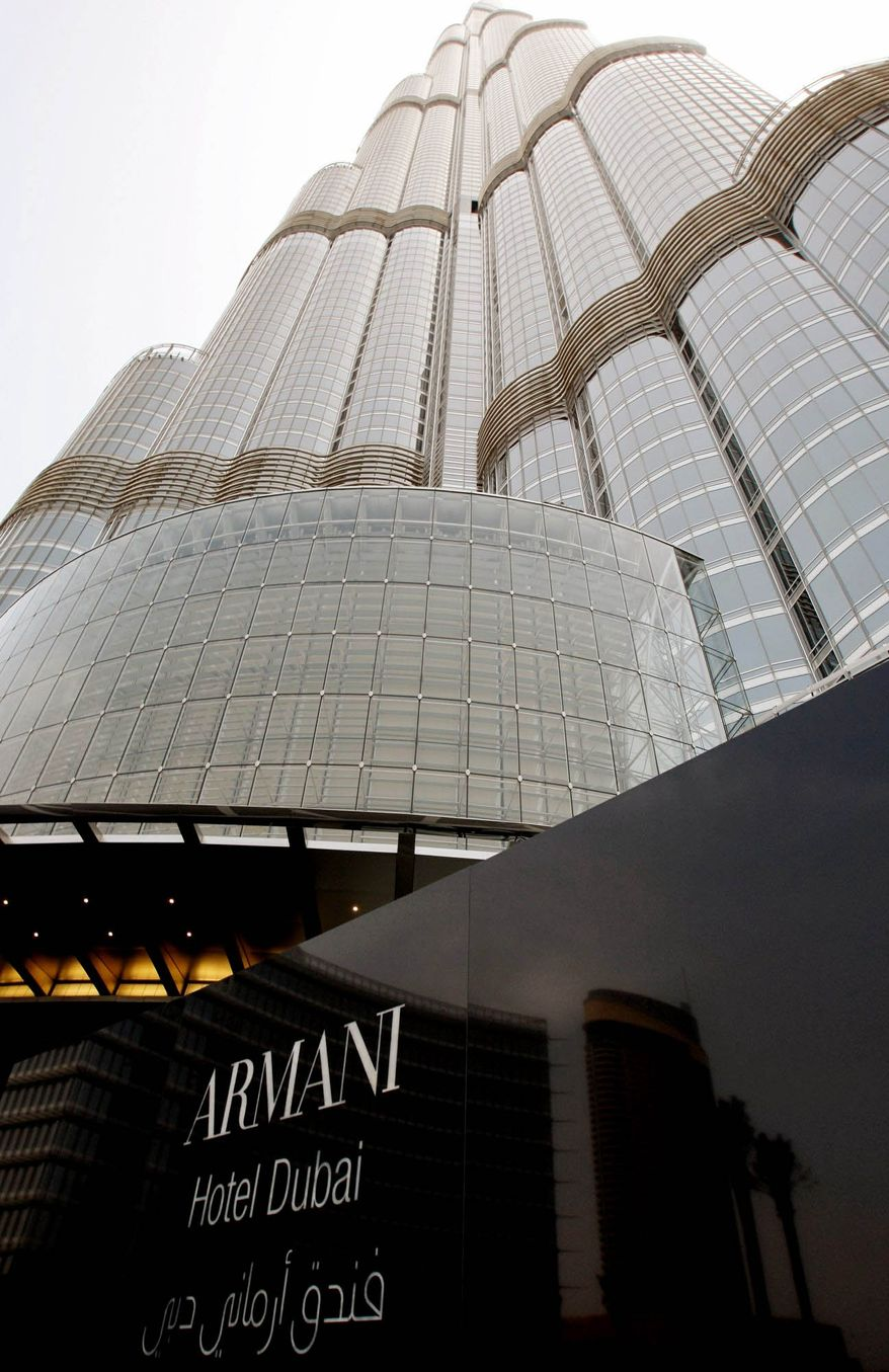 The world's first Armani Hotel in the Burj Khalifa, the world's tallest building, is located in Dubai, United Arab Emirates, where oil production and sales are likely to benefit from the political upheavals in neighboring countries. (Associated Press)