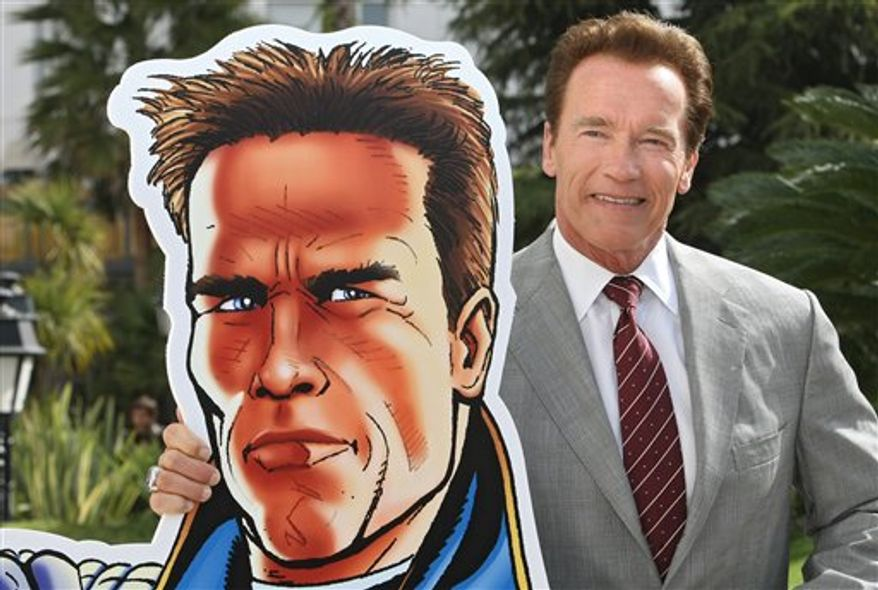 "Austrian-American, actor and former California Governor Arnold Schwarzenegger, makes a cast of his hands during the MIPTV (International Television Programme Market), Monday, April 4, 2011, in Cannes, southern France. Arnold Schwarzenegger is back in Cannes for the first time in eight years to unveil a new international television series ""The Governator"". (AP Photo/Lionel Cironneau)"