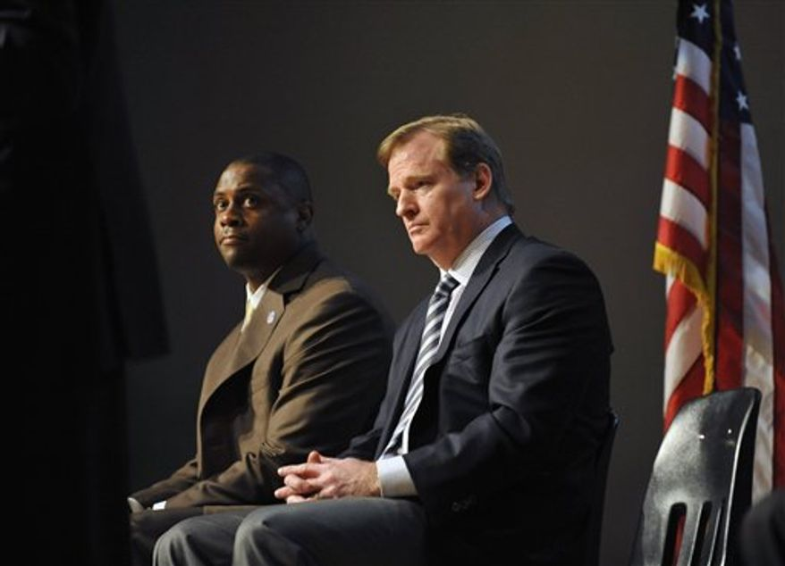 NFL Vice President and former NFL player Troy Vincent, Sr. speaks to  students about the dangers of steroid use as Congressman Elijah Cummings, D-Md center,, and NFL Commissioner Roger Goodell applaud Monday, April 4, 2011 at Woodlawn High School in Woodlawn, Md.(AP Photo/Gail Burton)