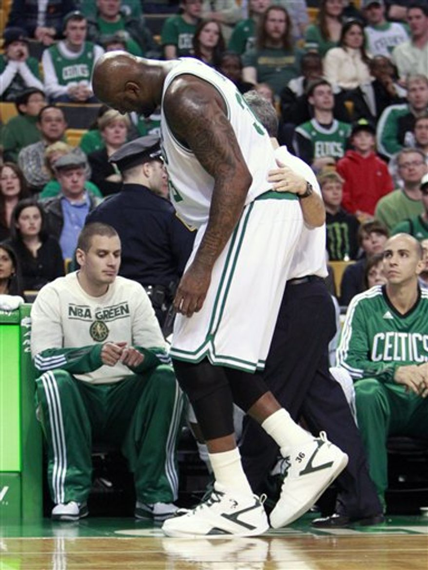 Detroit Pistons' Tayshaun Prince (22) shoots over Boston Celtics' Von Wafer in the fourth quarter of an NBA basketball game on Sunday, April 3, 2011, in Boston. The Celtics won 101-90. (AP Photo/Michael Dwyer)