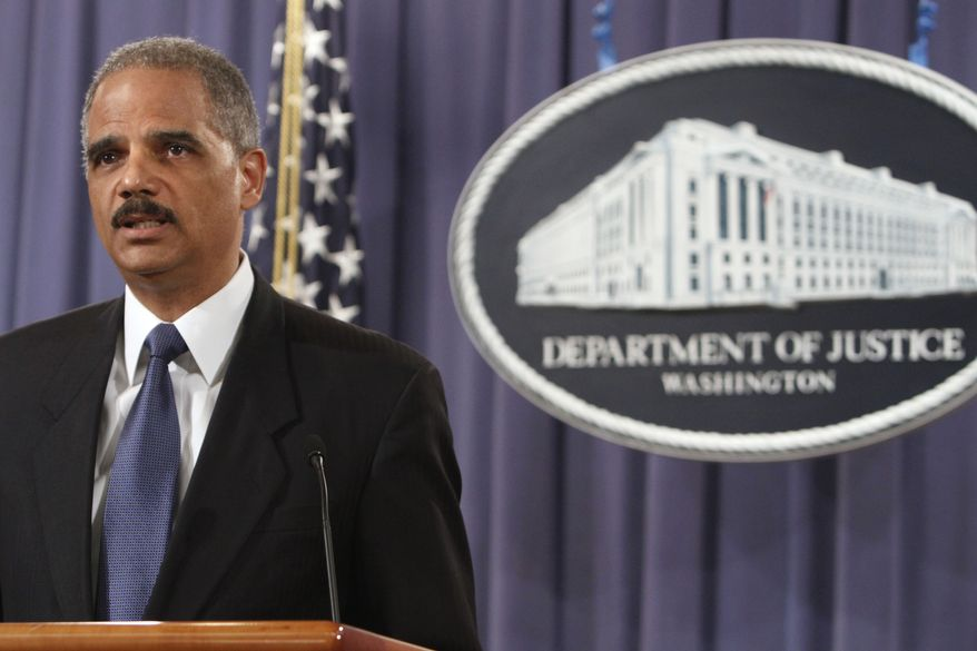 TURNABOUT: Attorney General Eric H. Holder Jr. blamed hindrances by members of Congress. (Associated Press)