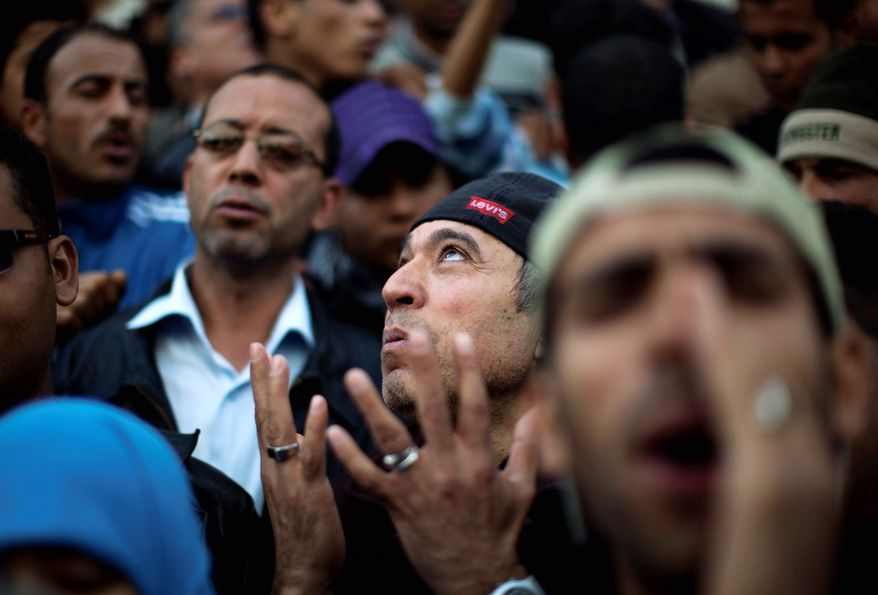 A demonstrator gets emotional during a recent protest in downtown Tunis. Tunisians in this tiny country of 10.5 million people cherish their new freedom. But the country's high unemployment and deeply entrenched corruption could take years to remedy. (Associated Press)