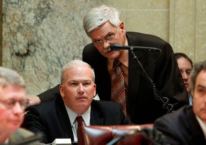 Wisconsin state Sen. Mark Miller (standing) talks to Senate Majority Leader Scott Fitzgerald, a Republican, during a session at the Capitol in Madison, Wis., on Tuesday. (Associated Press)