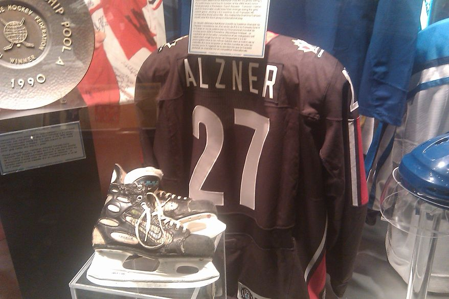Karl Alzner's Team Canada jersey on display at the Hockey Hall of Fame in Toronto, Ontario. (Stephen Whyno, The Washington Times)