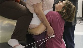 In this March 25, 2011 photo, a brain trauma patient at the TIRR rehabilitation facility in Houston has words of inspiration written on the cast on his knee.  Rep. Gabrielle Giffords has been undergoing rehabilitation at the TIRR clinic. (AP Photo/Pat Sullivan)