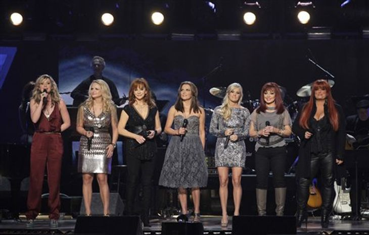 Blake Shelton and Miranda Lambert are seen onstage at the Girls' Night Out: Superstar Women of Country in Las Vegas on Monday, April 4, 2011. (AP Photo/Julie Jacobson)