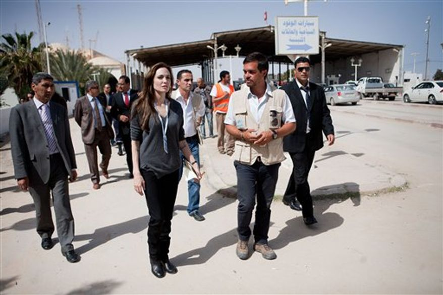 United Nations High Commissioner for Refugee goodwill ambassador Angelina Jolie visits Somali refugees at Shousha Camp, located 8 kilometres from the Tunis-Libyan boder at Ras Djir on Tuesday, April 5, 2011. Jolie traveled on Tuesday morning to the Tunisian-Libyan border to urge greater international support for people fleeing Libya. (AP Photo/UNHCR, Jason Tanner)