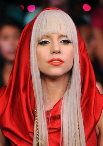 """FILE - In this Aug. 12, 2008, file photo Lady Gaga makes an appearance at MTV Studio's in Times Square for MTV's """"Total Request Live"""" show in New York. Lady Gaga and Tyler the Creator lead MTV's newly inaugurated O Music Awards with three nominations each,MTV announced Tuesday, April 5, 2011.  (AP Photo/Peter Kramer, File)"""