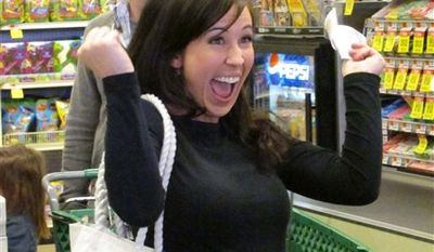 "In this undated TV publicity image released by TLC, Chrystie Corns reacts as she participates in the new series ""Extreme Couponing,"" which follows shoppers whose intense devotion to finding bargains and whittle a large grocery store bill down to a few dollars. TLC's opening episode is scheduled for Wednesday,April 6, 2011 at 9 p.m. ET. (AP Photo/TLC)"