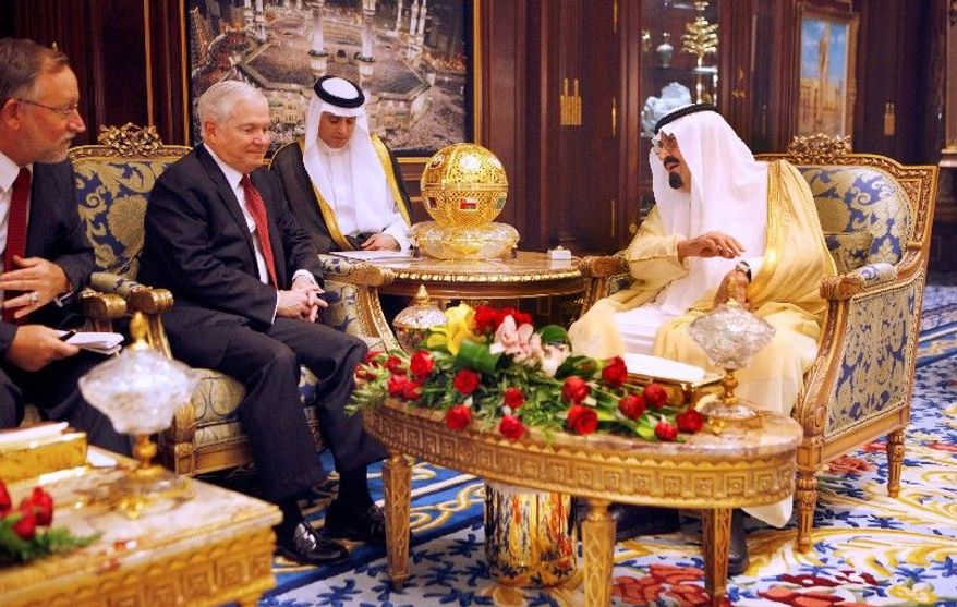 U.S. Defense Secretary Robert Gates talks with Saudi Arabia's King Abdullah as Ambassador to the U.S. Adel Al-Jubair (center) translates on Wednesday at the king's Palace in Riyadh, Saudi Arabia. The largely Sunni Muslim nation is a U.S. ally. (Associated Press)
