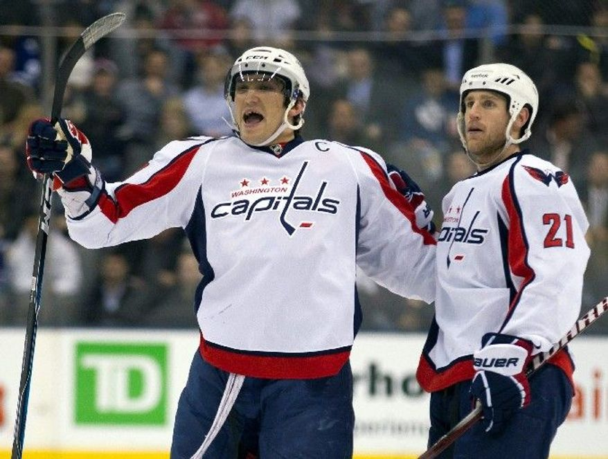 Capitals captain Alex Ovechkin celebrates scoring his 300th career goal Tuesday in Toronto. Ovechkin hasn't gone more than three games without a goal since mid-January. (Associated Press)