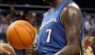 Washington Wizards power forward Andray Blatche averaged 16.8 points per game and 8.2 rebounds last season. (Associated Press file)