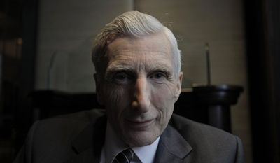 British astrophysicist  Martin Rees, poses in central London,Tuesday April 5, 2011.  Rees known for his theories on the origin and the destiny of the universe has been honored with one of the world's leading religion prizes.  Martin Rees, a 68-year-old expert on the extreme physics of black holes and the Big Bang, is the recipient of the 2011 Templeton Prize, the John Templeton Foundation announced Wednesday April 6, 2011 . The 1 million pound ($1.6 million) award is among the world's most lucrative. (AP Photo/Lefteris Pitarakis)