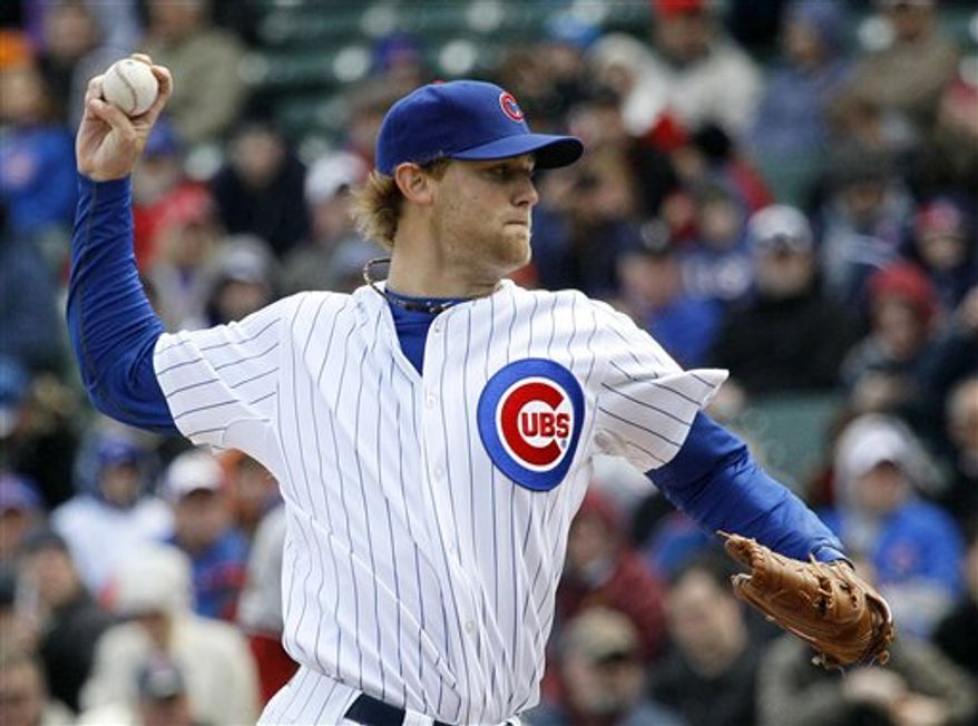 In this photo taken Monday, April 4, 2011, Chicago Cubs starting pitcher Andrew Cashner delivers during  a baseball game against the Arizona Diamondbacks in Chicago. Cashner and Randy Wells will be sidelined at least two weeks because of arm strains, Cubs general manager Jim Hendry said Wednesday, April 6, 2011. (AP Photo/Charles Rex Arbogast)
