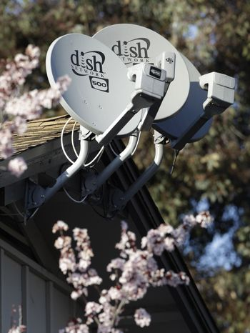 ** FILE ** In this file photo taken Feb. 23, 2011, three Dish Network satellite dishes are shown at an apartment complex in Palo Alto, Calif. Dish Network Corp. said Wednesday, April 6, 2011, it won the auction for Blockbuster Inc. with a bid valued at $228 million in cash.(AP Photo/Paul Sakuma, file)
