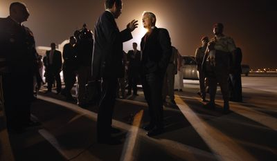 Defense Secretary Robert M. Gates (center) talks with his press secretary, Geoff Morrell, on the airport apron before departing from Riyadh, Saudi Arabia, on Wednesday, April 6, 2011. Mr. Gates earlier met with King Abdullah. (AP Photo/Chip Somodevilla, Pool)