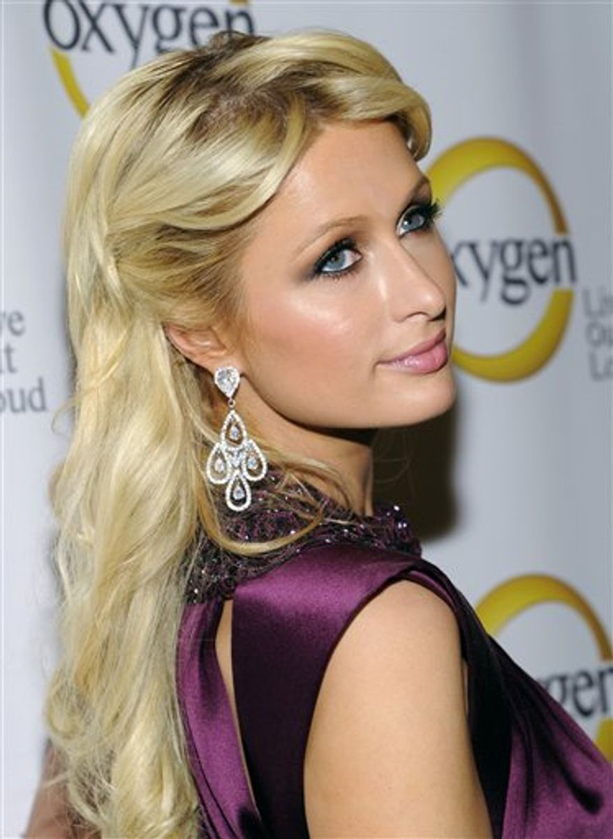 Television personality Paris Hilton attends the Oxygen network upfront at Gotham Hall on Monday, April 4, 2011 in New York. (AP Photo/Evan Agostini)