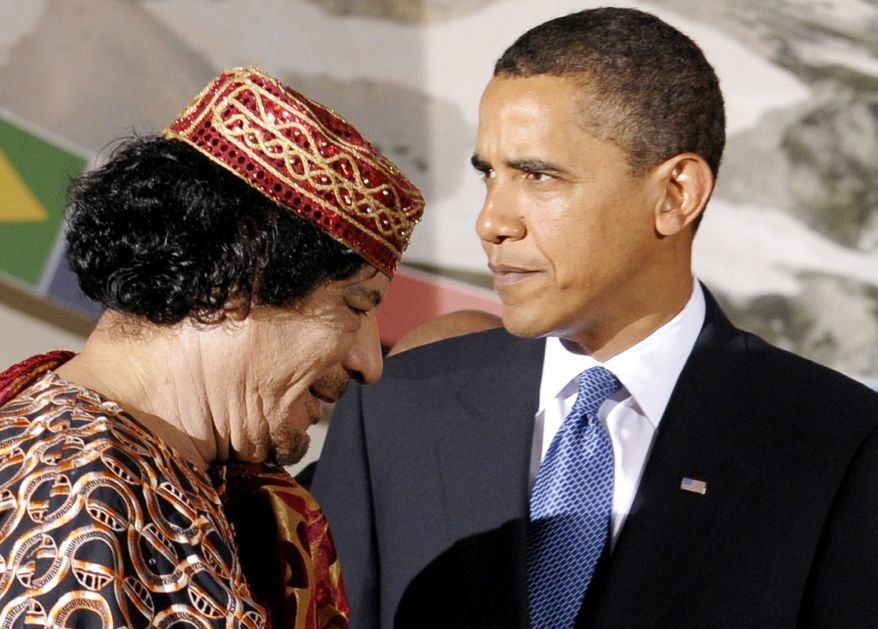 ** FILE ** Col. Moammar Gadhafi (left) and President Obama are pictured during the G-8/G-5 summit in L'Aquila, Italy, in July 2009. (AP Photo/Michael Gottschalk/Pool, File)