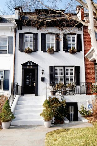 The home at 2218 Cathedral Ave. NW in Woodley Park is on the market for $1,198,555. The row home, built in 1923 and renovated in 2008, faces Rock Creek Park.