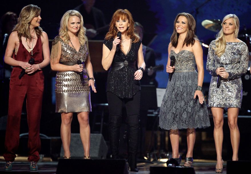 """From left, Jennifer Nettles, Miranda Lambert, Reba McEntire, Martina McBride and Carrie Underwood perform at """"Girls Night Out: Superstar Women of Country"""" in Las Vegas on Monday. (Associated Press)"""
