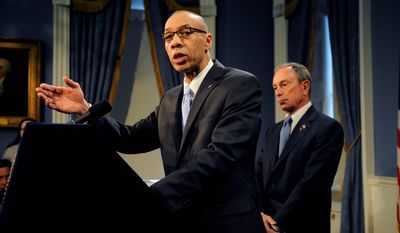 New York City Deputy Mayor Dennis Walcott answers reporters' questions Thursday after he was hastily appointed to the position of schools chancellor by Mayor Michael R. Bloomberg. Initial reaction to Mr. Walcott, who attended the city's public schools in his youth, was largely positive. Mr. Walcott's predecessor lasted fewer than 100 days before she was forced out. (Associated Press)