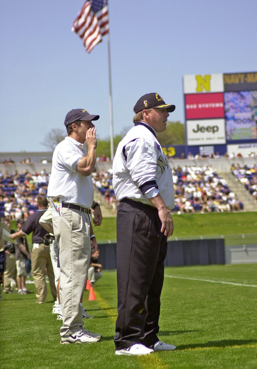 "Navy lacrosse coach Richie Meade (center) and then Navy assistant John Tillman (behind) guide the Navy lacrosse team from the sidelines. Tillman now is head coach at Maryland and he'll be facing his former team for the first time in a regular-season game Friday. ""I still have a job to do. I owe it to my kids to put them in the best position to win. That's been my focus,"" he said. (Navy Athletics)"