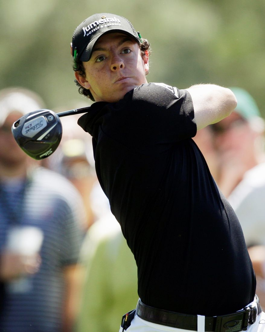 Rory McIlroy (seen here) of Northern Ireland is tied with Alvaro Quiros of Spain for the lead after the first day of the Masters at Augusta National. They both shot 65s, with McIlroy playing early and Quiros playing in the final threesome. (Associated Press)