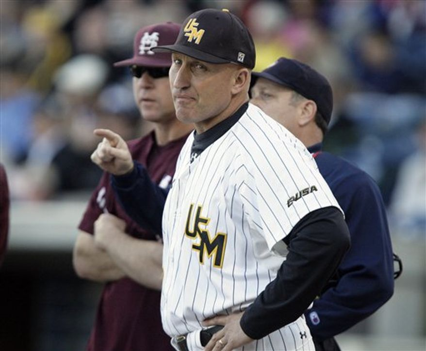 Southern Miss baseball coach Scott Berry, foreground, looks around Trustmark Park in Pearl, Miss., April 5, 2011, as instructions are give to him and Mississippi State baseball coach John Cohen, background, prior to their NCAA college baseball game. Berry believes the talent parity among the colleges is a reason for their Conference USA teams' success against SEC teams. (AP Photo/Rogelio V. Solis)