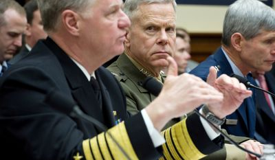 """POSITIVE FEEDBACK: Adm. Gary Roughead (left), chief of naval operations, and  Gen. James F. Amos, Marine Corps commandant, testify to the House Armed Services Committee about ending the """"don't ask, don't tell"""" policy for homosexuals. (Rod Lamkey Jr./The Washington Times)"""