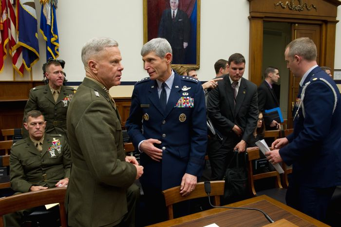 "Gen. James F. Amos (left), commandant of the Marine Corps, confers with Gen. Norton Schwartz, Air Force chief of staff, as they take a break from testifying before the House Armed Services Committee on Thursday about progress toward ending the ""don't ask, don't tell"" policy for gays serving in the military. (Rod Lamkey Jr./The Washington Times)"