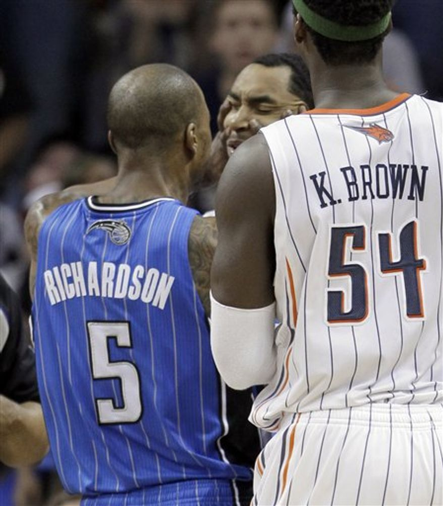Orlando Magic's Dwight Howard (12) and Hedo Turkoglu (15), of Turkey, react after Howard received a technical foul in the first half of an NBA basketball game against the Charlotte Bobcats in Charlotte, N.C., Wednesday, April 6, 2011. (AP Photo/Chuck Burton)