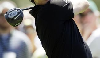Rory McIlroy watches his tee shot on the 18th hole Thursday during the first round of the Masters golf tournament in Augusta, Ga. (Associated Press)