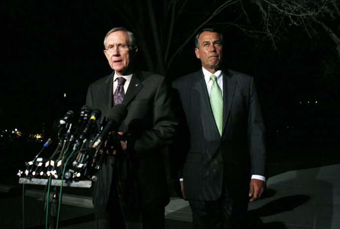 House Speaker John A. Boehner (right), Ohio Republican, and Senate Majority Leader Harry Reid, Nevada Democrat, speak to reporters after their meeting at the White House in Washington with President Obama regarding the budget and possible government shutdown, on Wednesday, April 6, 2011. (AP Photo/Charles Dharapak)