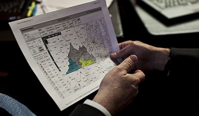 Republican delegates Bill Carrico and Terry Kilgore look at a redistricting map on the House floor of the Capitol, in Richmond, Wednesday, April 6, 2011. (Drew Angerer/The Washington Times)