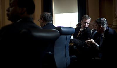 Del. David Bulova, D-Fairfax, center, talks with Del. Thomas Greason, R-Loudoun, during debate on the Republican sponsored state redistricting plan, during a House session at the Capitol, in Richmond, Va., Tuesday, April 5, 2011. (Drew Angerer/The Washington Times)